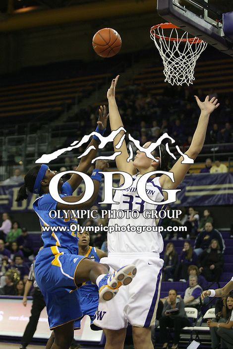 December 31, 2010:  Washington Huskies center #33 Mackenzie Argens tries to block the shot of UCLA's #23 Markel Walker.  UCLA defeated Washington 60-48 at Hec Ed Arena in Seattle, WA.