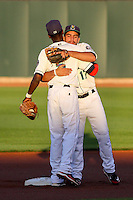 Cedar Rapids Kernels shortstop Nick Gordon (5) and infielder Rafael P Valera (17) exchange hugs prior to the start of game five of the Midwest League Championship Series against the West Michigan Whitecaps on September 21st, 2015 at Perfect Game Field at Veterans Memorial Stadium in Cedar Rapids, Iowa.  West Michigan defeated Cedar Rapids 3-2 to win the Midwest League Championship. (Brad Krause/Four Seam Images)