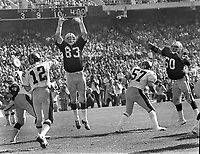 Oakland Raiders Ted Hendricks jumps to block pass of Pittsburg Steeler Terry Bradshaw. #60 Otis Sistrunk<br />