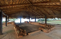 La Casa del Almirante, or House of the Admiral, the only house owned by Christopher Columbus in the Americas, in the archaeological centre of the Parque Nacional Historico y Arqueologico de La Isabela, or Historical National Park of La Isabela, one of the oldest European settlements in the New World, in Luperon province, on the North coast of the Dominican Republic, in the Caribbean. This is a 2 storey military building with lookout, low walls and a thatched roof. The town of La Isabela was founded in 1493 by Christopher Columbus and a fort, houses, church, warehouses, and an arsenal were built, but the settlement was abandoned in 1496 due to hurricane damage. Picture by Manuel Cohen