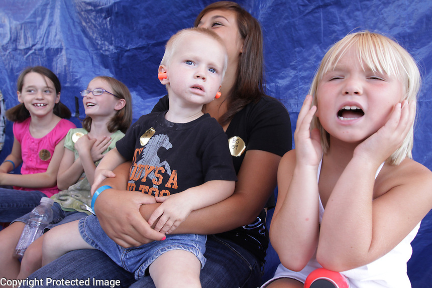 Katlyn (cq) Neff, 7, and brother Reuben Neff, 2, watch the demoltion derby at the NW Washington Fair. Their grandfather is in charge of the derby and their parents Wendy and Josh are announcers. August 17, 2009 PHOTO BY MERYL SCHENKER....schenker IMG_4472.JPG