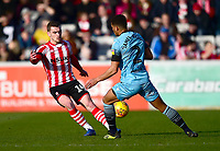 Lincoln City's Harry Toffolo clears under pressure from Stevenage's Luther Wildin<br /> <br /> Photographer Andrew Vaughan/CameraSport<br /> <br /> The EFL Sky Bet League Two - Lincoln City v Stevenage - Saturday 16th February 2019 - Sincil Bank - Lincoln<br /> <br /> World Copyright © 2019 CameraSport. All rights reserved. 43 Linden Ave. Countesthorpe. Leicester. England. LE8 5PG - Tel: +44 (0) 116 277 4147 - admin@camerasport.com - www.camerasport.com