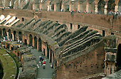 Rome, Italy - April 2, 2006 -- Interior view of The Colosseum in Rome, Italy on Sunday, April 2, 2006.  Its construction was commissioned by the Roman Emperor Vespasian in AD 72 and was completed in AD 80.  It is considered as Rome's greatest amphitheatre. Deadly gladiatorial combats and wild animal fights were staged there by emperors and wealthy citizens.  It had a capacity of 55,000 people..Credit: Ron Sachs / CNP