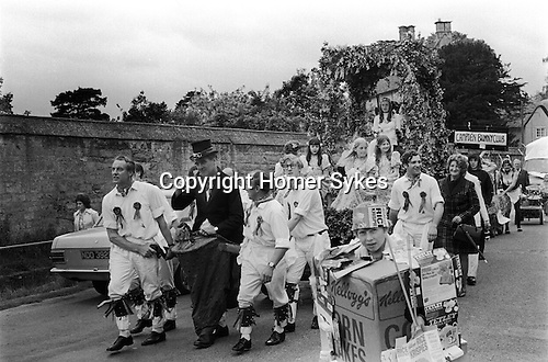 Scuttlebrook Wake Chipping Camden Gloucestershire1973. May Queen being draw around the town by the local Morris Men team.