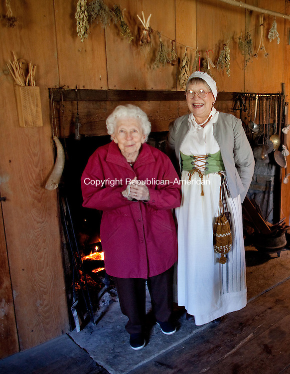 WOODBURY, CT-22 November 2012-112212BF06--FOR COUNTRY LIFE- Visitor Lucille Terrell from Woodbury talks with volunteer Susan Cheatham, also from Woodbury, who was dressed in late 17th century costume, at the Hurd House as part of The Old Woodbury Historical Society Thanksgiving Day open house Thursday. The Hurd House (ca. 1680) is recognized as the oldest original house. It was the home of John Hurd who became the town miller in August 1681.          Bob Falcetti Republican-American