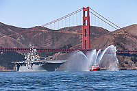 United States Navy Wasp-class amphibious assault ship USS Essex (LHD-2) follows San Francisco's newest Fireboat through the Golden Gate and onto San Francisco Bay