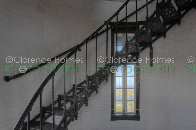 View of spiral staircase and window of the St. Augustine lighthouse.  The lighthouse, built in 1874, is 165 feet tall, has 219 steps, and 8 landings.