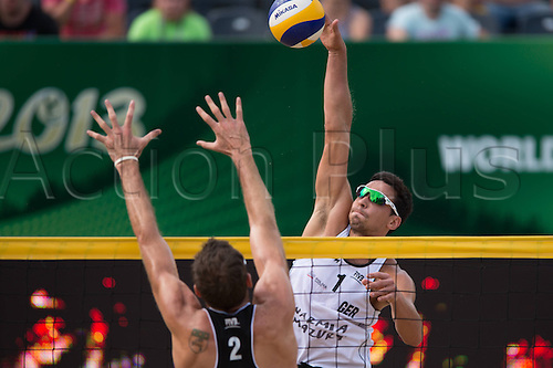05.07.2013. Stare Jablonki, Poland.  FIVB Beach Volleyball World Cup   Block Ryan Doherty USA Attack Jonathan Erdmann 1 ger