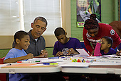 United States President Barack Obama participates in a literacy service project at the Boys & Girls Club of Greater Washington, DC in celebration of the Martin Luther King, Jr. Day of Service, in Washington, D.C., Monday, January 19, 2015.<br /> Credit: Martin H. Simon / Pool via CNP