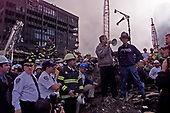 United States President George W. Bush speaks to the assembled first responders as he tours the devastation at the World Trade Center in New York, New York on September 14, 2001.<br /> Credit: Consolidated News Photos