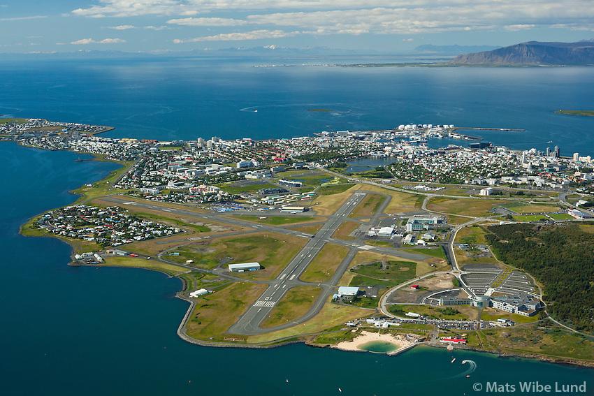 Reykjavíkurflugvöllur séð til norðurs. Tjörnin og miðbærin..Háskóli Reykjavíkur i forgrunni t.h..Reykjavík airport aerial view of all runways. Lake Tjörnin at the end of the runway. Further north is the capital centre. Viewing north.,