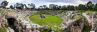 Syracuse, panoramic photo of the Roman Amphitheatre at Syracuse (Siracusa), UNESCO World Heritage Site, Sicily, Italy, Europe. This is a panoramic photo of the Roman Amphitheatre at Syracuse (Siracusa), UNESCO World Heritage Site, Sicily, Italy, Europe.