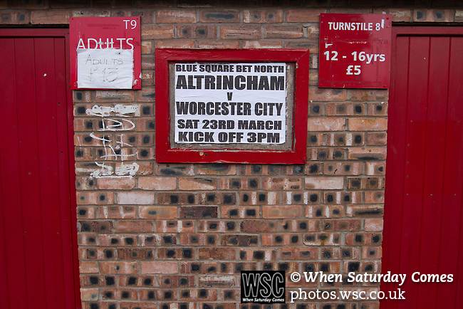 Altrincham 2 Worcester City 0, 23/03/2013. Moss Lane, Blue Square Bet North. A poster  next to the turnstiles advertising  the day's Blue Square Bet North fixture between Altrincham and Worcester City at Moss Lane, Altrincham. The home team won the match 2-0 watched by 777 spectators on a day when most non-League football in England was cancelled due to adverse weather. Altrincham were historically one of the major English non-League teams but have never been promoted to the Football League. Photo by Colin McPherson.