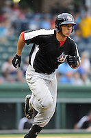 Catcher Jorge Alfaro (11) of the Hickory Crawdads in a game against the Greenville Drive on Sunday, June 9, 2013, at Fluor Field at the West End in Greenville, South Carolina. Alfaro is the No. 9 prospect of the Texas Rangers, according to Baseball America. Hickory won, 6-3. (Tom Priddy/Four Seam Images)
