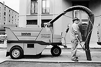 Switzerland. Geneva. Garbage collectors. Streets cleaning. Both, a street sweeper  (garbage man) and  a brooming machine, called the elephant, are cleaning the street. © 1991 Didier Ruef
