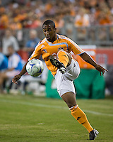 Houston Dynamo midfielder Corey Ashe (26) controls the ball.  Houston Dynamo defeated Pachuca FC 2-0 in the semifinals of the Superliga 2008 tournament at Robertson Stadium in Houston, TX on July 29, 2008.