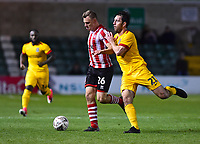 Lincoln City's Harry Anderson shields the ball from Northampton Town's John-Joe O'Toole<br /> <br /> Photographer Andrew Vaughan/CameraSport<br /> <br /> Emirates FA Cup First Round - Lincoln City v Northampton Town - Saturday 10th November 2018 - Sincil Bank - Lincoln<br />  <br /> World Copyright &copy; 2018 CameraSport. All rights reserved. 43 Linden Ave. Countesthorpe. Leicester. England. LE8 5PG - Tel: +44 (0) 116 277 4147 - admin@camerasport.com - www.camerasport.com