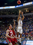 SIOUX FALLS, SD - MARCH 9: George Marshall #11 of SDSU shoots a 3 over the heads of USD defenders in the first half of their semi-final round Summit League Championship Tournament game Monday evening at the Denny Sanford Premier Center in Sioux Falls, SD. (Photo by Dick Carlson/Inertia)