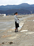 March 11, 2012, Rikuzentakata, Japan - A lone Japanese woman stands on an empty lot where her home was a year ago in  Rikuzentakata, Iwate Prefecture, some 402 km northeast of Tokyo, on Sunday, March 11, 2012..Memorial ceremonies were held throughout Japan to mark the one year anniversary of the massive earthquake and tsunami that struck the country?fs northeastern region, killing just over 19,000 people and unleashing the world?fs worst nuclear crisis in a quarter century. The quake was the strongest recorded in the nation?fs history, and set off a tsunami that towered more than 65 feet in some spots along the northeastern coast, destroying thousands of homes and wreaking widespread destruction. (Photo by Natsuki Sakai/AFLO) AYF -mis-