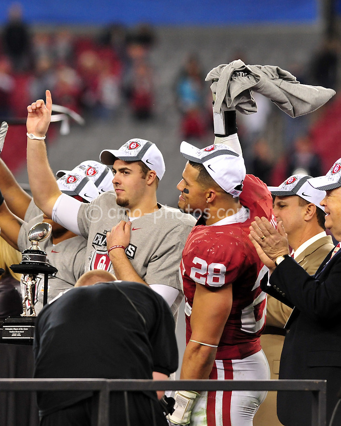 Jan 1, 2011; Glendale, AZ, USA; Oklahoma Sooners quarterback Landry Jones (12) and linebacker Travis Lewis (28) celebrate after a 48-20 victory over the Connecticut Huskies in the 2011 Fiesta Bowl at University of Phoenix Stadium.  The Sooners won the game 48-20.