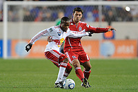 Dane Richards (19) of the New York Red Bulls and Peter Lowry (8) of the Chicago Fire battle for a ball during the first half of a Major League Soccer match between the New York Red Bulls and the Chicago Fire at Red Bull Arena in Harrison, NJ, on March 27, 2010. The Red Bulls defeated the Fire 1-0.