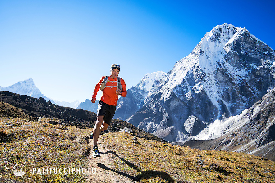 Ueli Steck trail running in the Khumbu Valley of the Nepal Himalaya, with Cholatse in the background, during his acclimating process for a climbing expedition. Ueli stayed in Dzonghla where he would run trails, run Lobuche Peak, and climb Cholatse before his primary objective, Nuptse.
