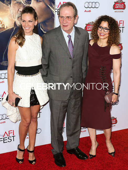 HOLLYWOOD, LOS ANGELES, CA, USA - NOVEMBER 11: Hilary Swank, Tommy Lee Jones, Dawn Laurel-Jones arrive at the AFI FEST 2014 - 'The Homesman' Gala Screening held at the Dolby Theatre on November 11, 2014 in Hollywood, Los Angeles, California, United States. (Photo by Xavier Collin/Celebrity Monitor)