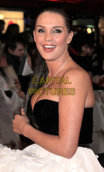 "DANIELLE LLOYD .""Marley & Me"" UK film premiere held at Vue cinema, Leicester Square, London, England..March 2nd, 2009. .half length black strapless white bustier tiered cleavage ruffled ruffles ruffle .CAP/ROS.©Steve Ross/Capital Pictures."