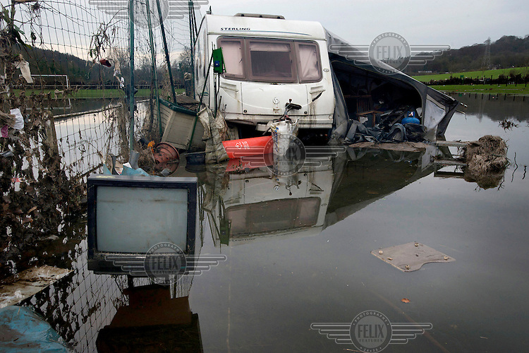 Flood water surrounds a caravan as a community of between 20 and 30 people lost their homes as static caravans and mobile homes were swept from their pitches in the grounds of the Esholt Sports and Leisure Club by floodwaters from the River Aire, and deposited further downstream.
