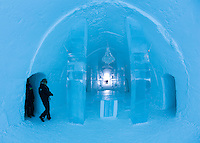 Sweden, SWE, Kiruna, 2006-Apr-12: A long corridor in the Jukkasjarvi icehotel with table and lustre made of ice.