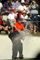 Masters Golf Tournament 2005, Augusta National Georgia, USA. Gary Player hits it out of the bunker on the 16th hole, Redbud.<br /> <br /> Champion 2005 - Tiger Woods <br /> <br /> Note: There is no property release or model release available for this image.