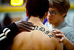 hamiltonp15 - Luis Resendiz of Bradley Tech, one their best wrestlers loses to Hunter Weber of Marshall, and is consoled by a teammate as well as one of the coaches of the team, in Milwaukee on Thursday, December 23, 2010. Photographed by MARK ABRAMSON/MABRAMSON@JOURNALSENTINEL.COM