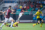 AC Milan Midfielder Hakan Calhanoglu (C) attempts a kick while being defended by Borussia Dortmund Midfielder Felix Passlack (L) during the International Champions Cup 2017 match between AC Milan vs Borussia Dortmund at University Town Sports Centre Stadium on July 18, 2017 in Guangzhou, China. Photo by Marcio Rodrigo Machado / Power Sport Images