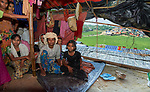 A Rohingya family sits in their shelter in the Jamtoli Refugee Camp near Cox's Bazar, Bangladesh. <br /> <br /> More than 600,000 Rohingya have fled government-sanctioned violence in Myanmar for safety in Bangladesh.