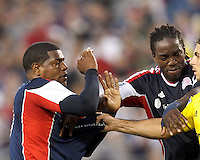 New England Revolution midfielder Shalrie Joseph (21) steps in to break up a scuffle. New England Revolution forward Jose Moreno (9). In a Major League Soccer (MLS) match, the New England Revolution tied the Columbus Crew, 0-0, at Gillette Stadium on June 16, 2012.