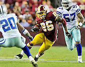 Washington Redskins running back Clinton Portis (26) eludes Dallas Cowboys' linebacker Victor Butler (57) and safety Alan Ball (20) in fourth quarter action at FedEx Field in Landover, Maryland on Sunday, September 12, 2010. The Redskins won the game 13 - 7..Credit: Ron Sachs / CNP
