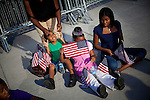 NEW YORK  --  SEPTEMBER 11, 2011:  Debra Meeks puts freshly cleaned glasses on her son Caleb Meeks, 8, while her daughters Kaylen Meeks, 8, and Teneal Colbert, 15 hold American flags before the ceremony honoring the tenth anniversary of the 9/11 attacks on September 11, 2011 in New York City.  (PHOTOGRAPH BY MICHAEL NAGLE FOR THE NEW YORK TIMES)