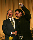 United States President George W. Bush, left, and rock singer, activist Bono, right, embrace after Bono speaks at the National Prayer Breakfast in Washington,DC on February 2, 2006.  <br /> Credit: Dennis Brack - Pool via CNP