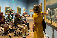 NWA Democrat-Gazette/CHARLIE KAIJO Museum Educator Kim Crowell of Rogers asks attendees to think of what the painting &quot;Along The River&quot; By William Trost <br />Richards reminds them of as Mark Linkous of Rogers points out details at the Crystal Bridges museum in Bentonville, AR on Monday, September 11, 2017. Creative Connections is a program for individuals in the early stages of Alzheimer&acirc;&euro;&trade;s or dementia and their care partners. Museum Educators facilitate interactive discussions of artworks in the galleries, followed by hands-on art activities in the studio. The discussions on the works are designed to stimulate memories and emotions between Alzheimer's patients and their caretakers.