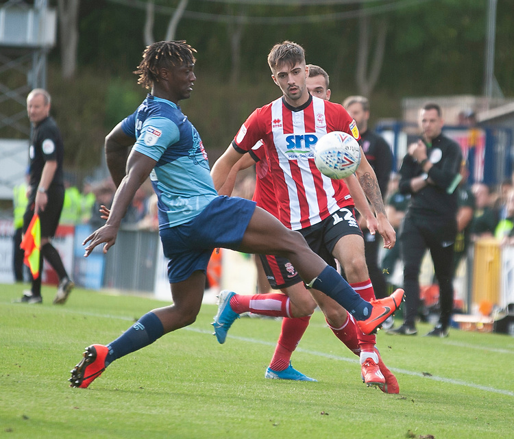 Lincoln City's Ellis Chapman vies for possession with Wycombe Wanderers' Anthony Stewart<br /> <br /> Photographer Andrew Vaughan/CameraSport<br /> <br /> The EFL Sky Bet League One - Wycombe Wanderers v Lincoln City - Saturday 7th September 2019 - Adams Park - Wycombe<br /> <br /> World Copyright © 2019 CameraSport. All rights reserved. 43 Linden Ave. Countesthorpe. Leicester. England. LE8 5PG - Tel: +44 (0) 116 277 4147 - admin@camerasport.com - www.camerasport.com