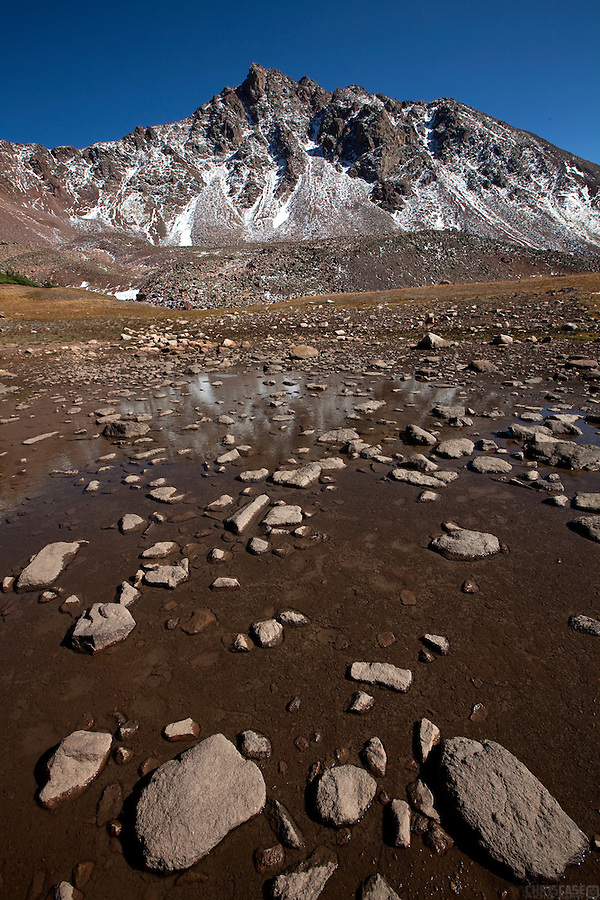 Snow Peak rises above the reflective ponds of the Deluge Lake basin, high in the Gore Range of the Eagles Nest Wilderness area, Colorado.