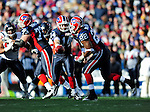 1 November 2009: Buffalo Bills' quarterback Ryan Fitzpatrick (14) hands off to running back Fred Jackson (22) during the 4th quarter against the Houston Texans at Ralph Wilson Stadium in Orchard Park, New York, USA. The Texans defeated the Bills 31-10. Mandatory Credit: Ed Wolfstein Photo