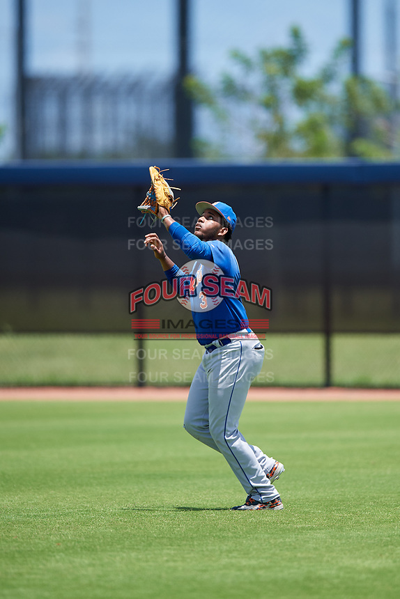 GCL Mets right fielder Edinson Valdez (3) settles under a fly ball during a game against the GCL Nationals on August 4, 2018 at FITTEAM Ballpark of the Palm Beaches in West Palm Beach, Florida.  GCL Nationals defeated GCL Mets 7-4.  (Mike Janes/Four Seam Images)