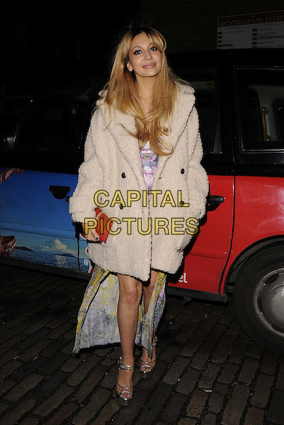 Zara Martin.The InStyle Best Of British Talent party, Shoreditch House, Ebor St., London, England..January 26th, 2012.full length white furry jackeT red pink clutch bag sheepskin .CAP/CAN.©Can Nguyen/Capital Pictures.