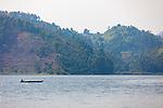Man In Dugout Canoe On Lake Mutanda