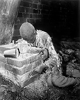This victim of Nazi inhumanity still rests in the position in which he died, attempting to rise and escape his horrible death.  He was one of 150 prisoners savagely burned to death by Nazi SS troops.  Gardelegen, Germany.  April 16, 1945.  Sgt. E. R. Allen.  (Army)<br /> NARA FILE #:  111-SC-203572<br /> WAR & CONFLICT BOOK #:  1115
