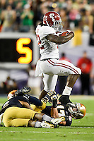 January 7, 2013: Alabama running back Eddie Lacy (42) attempts to leap over 2 Notre Dame defenders during 1st half of the Discover BCS National Championship game between the Alabama Crimson Tide and the Notre Dame Fighting Irish at Sun Life Stadium in Miami Gardens, Fl
