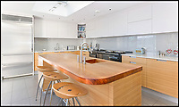 BNPS.co.uk (01202 558833)<br /> Pic: Savills/BNPS<br /> <br /> Bespoke kitchen...<br /> <br /> An award-winning waterfront home that has spectacular seaside views has gone on the market for £5m.<br /> <br /> The aptly named River House sits right on the Dart Estuary in Devon and has been so cleverly designed there is a glass floor in the master bedroom that looks down on the water.<br /> <br /> Its main living areas have floor-to-ceiling bi-fold doors and glass Juliet balconies to give the property a feel of Venice rather than Devon.<br /> <br /> Interestingly, the five bedroom house is being sold along with a nearby two bedroom town house that is owned by the same vendors.