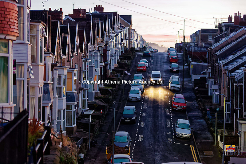 Ice has formed on the road during an early frosty morning in Cromwell Street, Swansea, Wales, UK. Tuesday 12 December 2017