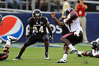 24 September 2011:  FIU linebacker Winston Fraser (34) pursues ULL quarterback Blaine Gautier (17) in the second quarter as the University of Louisiana-Lafayette Ragin Cajuns defeated the FIU Golden Panthers, 36-31, at FIU Stadium in Miami, Florida.